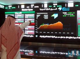 سوق الأسهم السعودي تنزل عن ذروة 4 سنوات