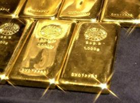 الذهب ينخفض إلى 1404.81 دولارا مسجلا أدنى مستوى في أسبوعين