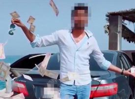 بعد انتشار فيديو له.. القبض على شاب يتفاخر برمي النقود بأحد شوارع دبي