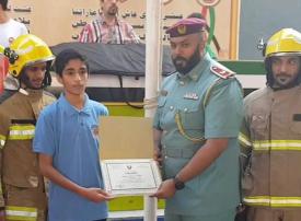 فتى إماراتي ينقذ أسرة من حريق في عجمان