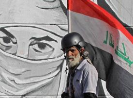 بالصور : مظاهرات العراق على الجدران
