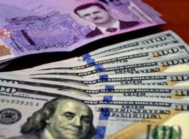 الليرة السورية تكسر حاجز الألف أمام الدولار