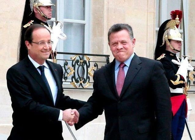 بالصور: الرئيس الفرنسي يلتقي الملك عبدالله الثاني في الإيليزيه