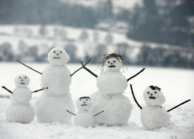 بالصور : الثلوج تحول العاصمة البريطانية لندن إلى مدينة بيضاء