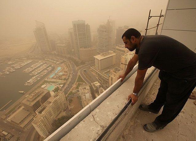 بالصور : عاصفة رملية تجتاح مناطق الشرق الأوسط