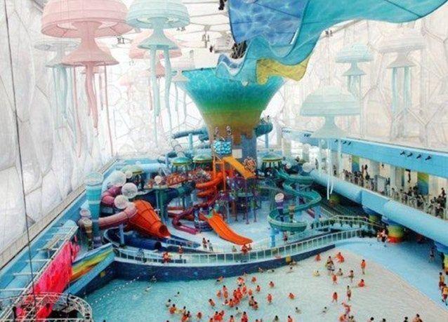 """صور أروع مدينة ألعاب في بكين.. """"ذاكيوب"""" مياه ملونة وألعاب مميزة"""
