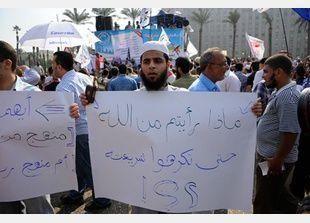 لجان الاقتراع في مصر تفتح أبوابها لبدء الاستفتاء على الدستور