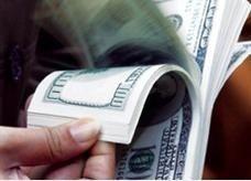اليوان الصيني يسجل مستوى قياسيا مرتفعا جديدا أمام الدولار الامريكي