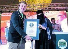 """امرأة سعودية تحطم رقمين قياسيين في """"جينيس"""""""