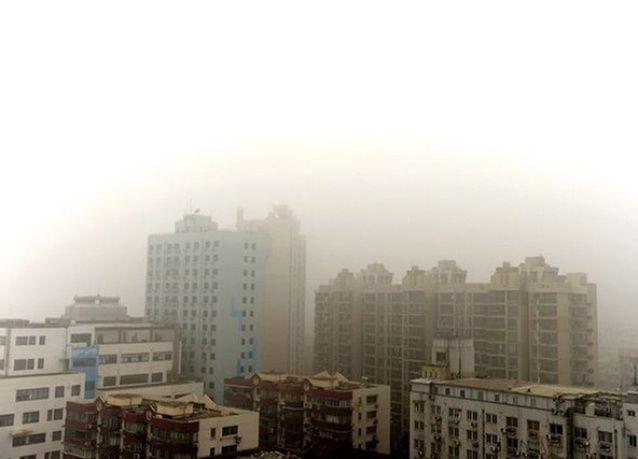 ضباب دخاني يهدد بكين بالتلوث الحاد .. بالصور