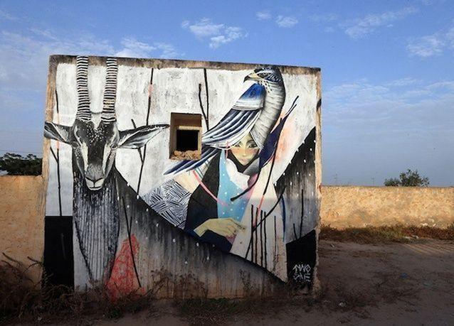 بالصور: روعة لوحات الشارع في قرية تونسية قديمة