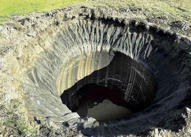 بالصور: حفر ضخمة وغامضة تُحيِّر العلماء في سيبيريا
