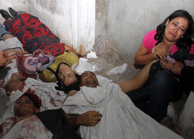 بالصور: مقتل وإصابة العشرات في موقعة ماسبيرو وسط القاهرة