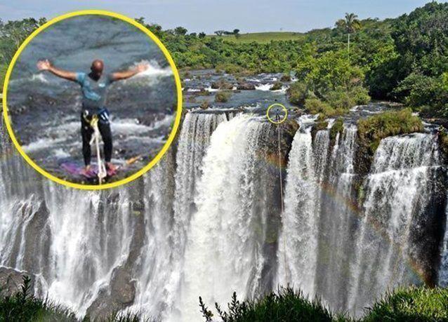 """بالصور: برازيلي يعبر """"قوس قزح"""" على حبل فوق شلال"""