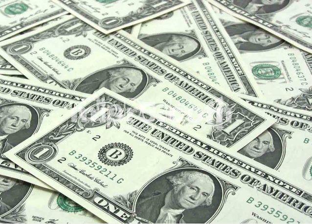 الدولار الأمريكي يصعد أكثر من 9% أمام سلة من العملات الرئيسية في 2015