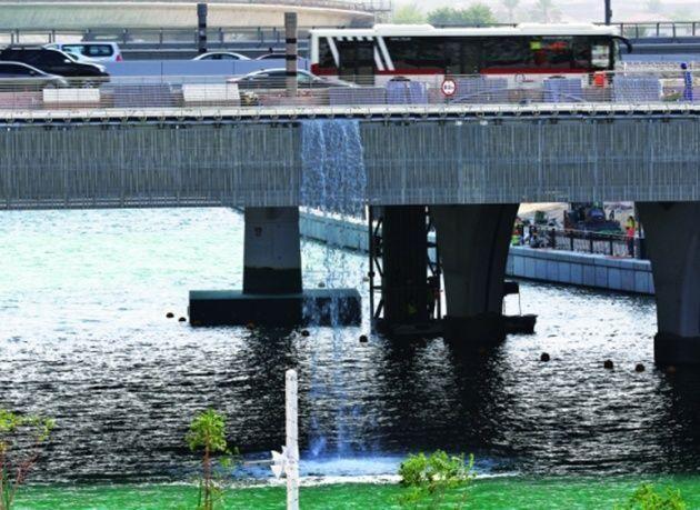 بالصور : لقطات أولية من تدفق شلال قناة دبي المائية