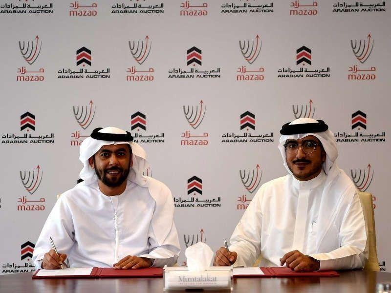 """""""العربية للمزادات"""" توقع إتفاقية لتنظيم أول مزاد علني في البحرين"""
