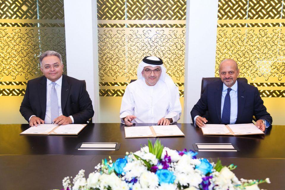 """""""أبوظبي للأوراق المالية"""" و""""دبي للذهب والسلع"""" يتفقان على إنشاء مركز مقاصة موحد"""