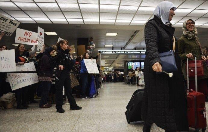 السماح لمن منعهم مرسوم ترامب من دخول أمريكا بطلب تأشيرة