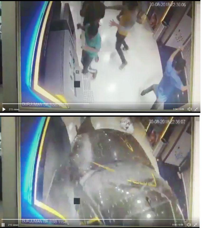 بالفيديو : إصابة شاب باقتحام مركبة لأحد البنوك في مركز برجمان بدبي