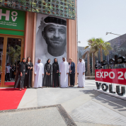 HE-Reem-Al-Hashimy-and-Abeer-Al-Hosani-with-Expo-2020-volunteers-outside-the-HoV.jpg