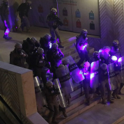 23752078-7918723-Special_forces_police_are_illuminated_by_laser_pointers_from_ant-a-19_1579744378478.jpg