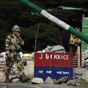 29682416-8430741-An_Indian_Border_Security_Force_soldier_walks_near_a_check_post_-a-33_1592391246868.jpg