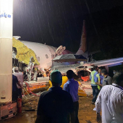 31688528-8606749-Officials_inspect_the_wreckage_site_of_a_plane_crash_at_Calicut_-a-34_1596877191452.jpg